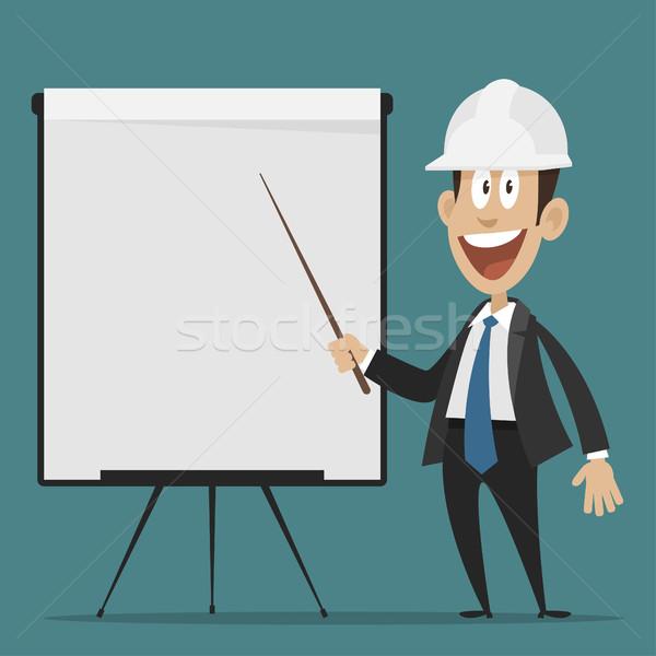 Cheerful builder points to flip chart Stock photo © yuriytsirkunov