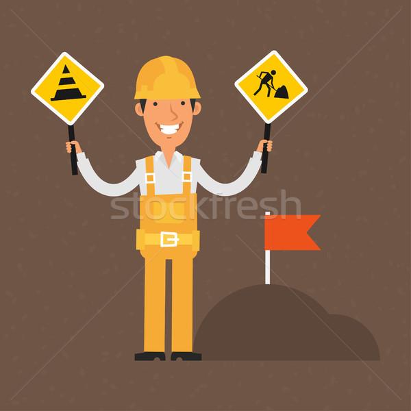 Builder holding signs ban and smiling Stock photo © yuriytsirkunov