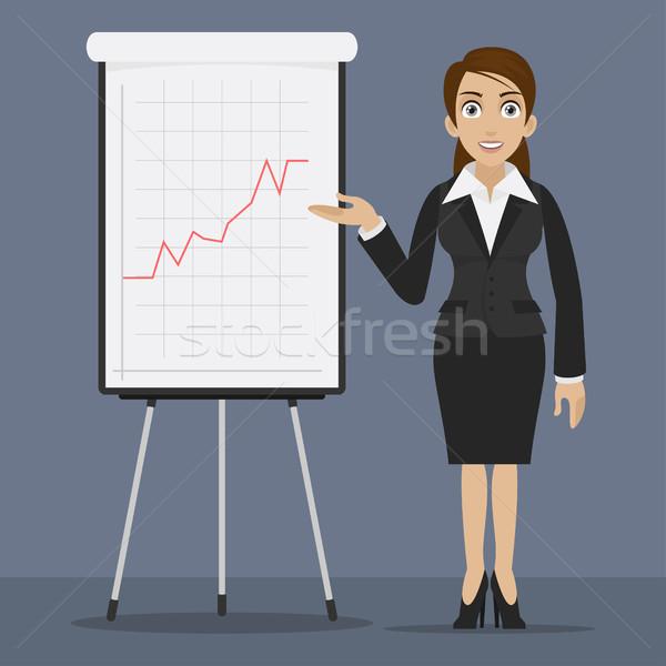 Businesswoman specifies on flip chart Stock photo © yuriytsirkunov