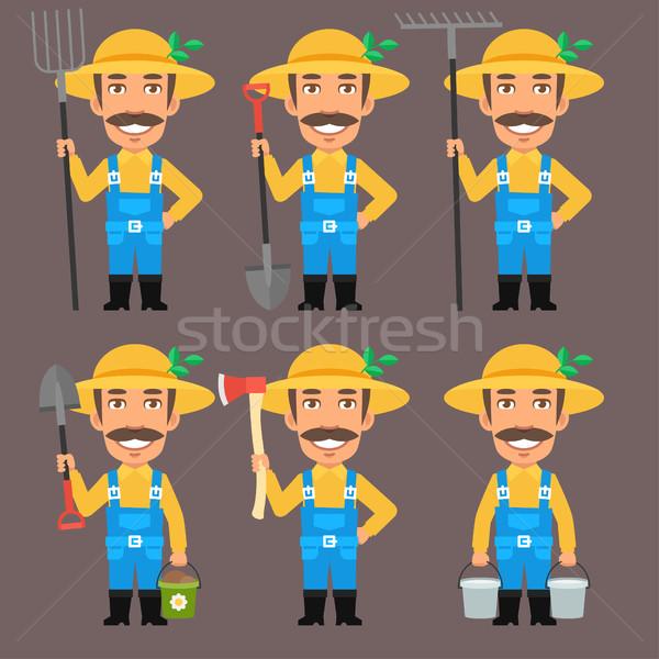 Farmer Holds Pitchfork Rake Bucket Shovel Ax Stock photo © yuriytsirkunov