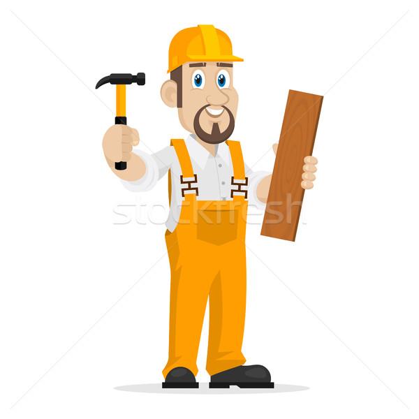 Builder holds hammer and wooden board Stock photo © yuriytsirkunov