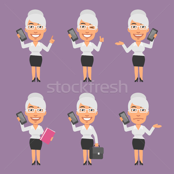 Old Businesswoman Holding Mobile Phone in Different Versions Stock photo © yuriytsirkunov