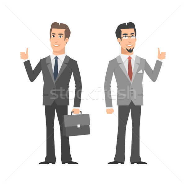 Two businessman smiling and showing thumbs up Stock photo © yuriytsirkunov
