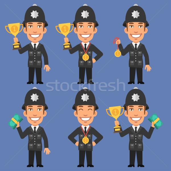 English Policeman Holds Cup Medal and Money Stock photo © yuriytsirkunov