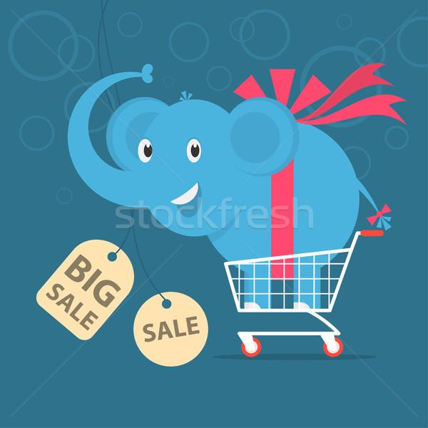 Elephant stands on shopping cart Stock photo © yuriytsirkunov