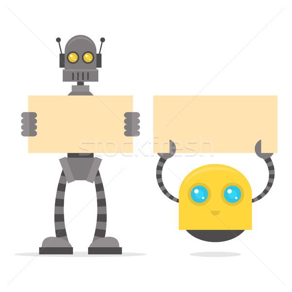 Robots holding blank poster Stock photo © yuriytsirkunov