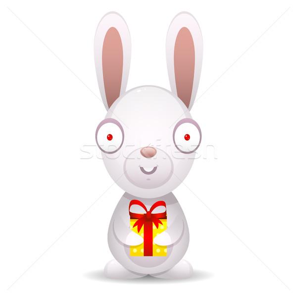 Rabbit holds packed gift Stock photo © yuriytsirkunov