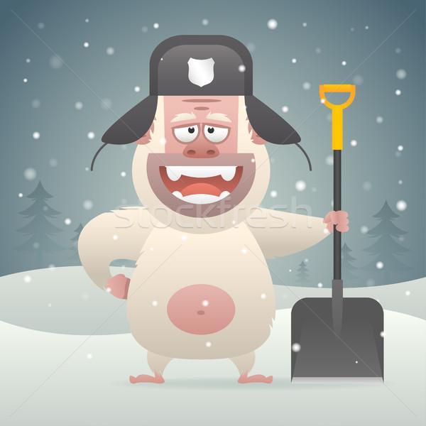 Yeti character holding shovel in winter forest Stock photo © yuriytsirkunov