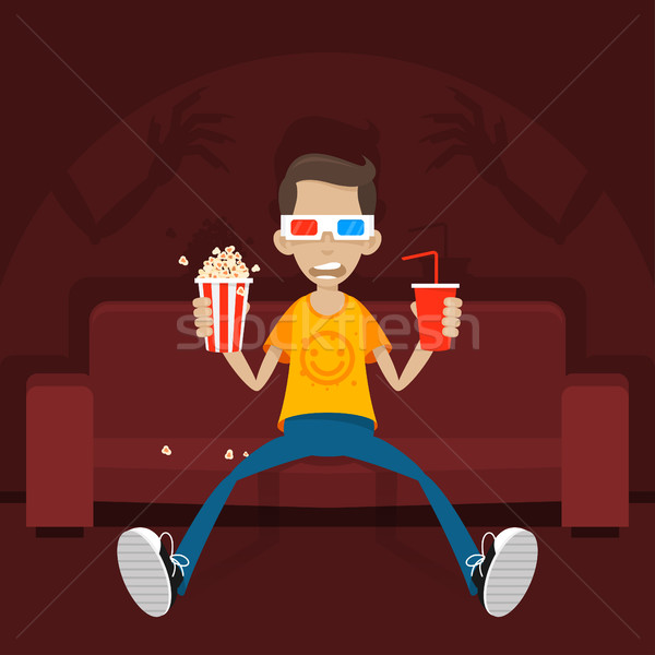 Teenager sits on sofa in 3D glasses Stock photo © yuriytsirkunov