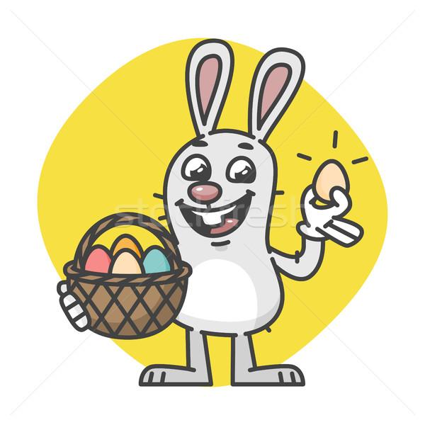 Húsvéti nyuszi tart kosárnyi tojás kabala karakter terv Stock fotó © yuriytsirkunov