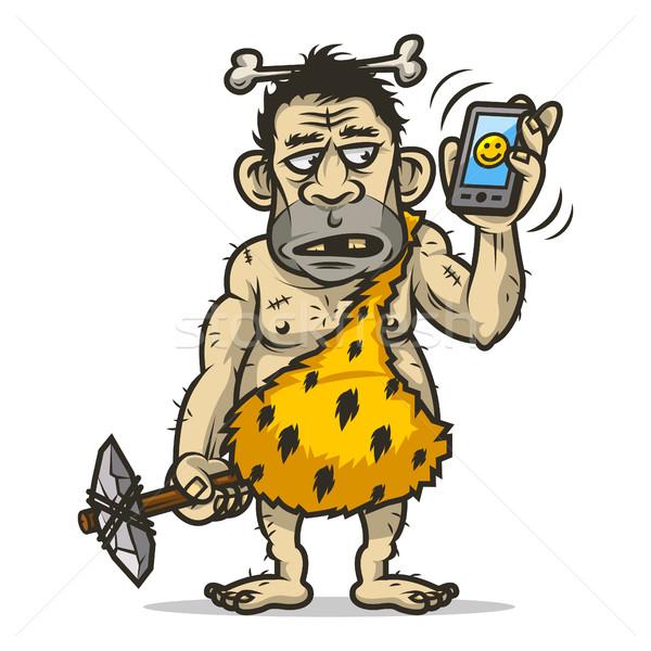 Neanderthal man holds mobile phone Stock photo © yuriytsirkunov