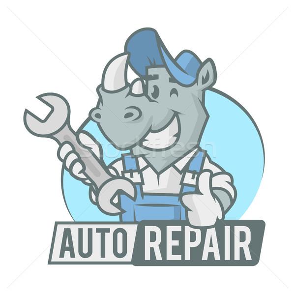 Rhinoceros emblem holding wrench Stock photo © yuriytsirkunov