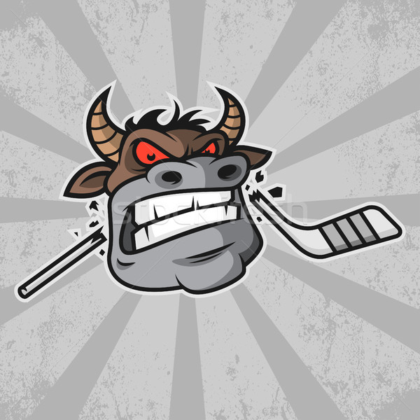 Bull bites hockey stick Stock photo © yuriytsirkunov