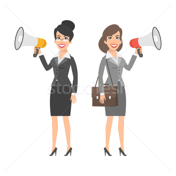 Two businesswomen holding speakers and smiling Stock photo © yuriytsirkunov