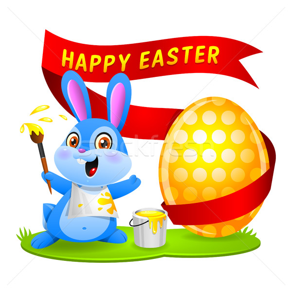 Easter bunny rabbit paints egg Stock photo © yuriytsirkunov