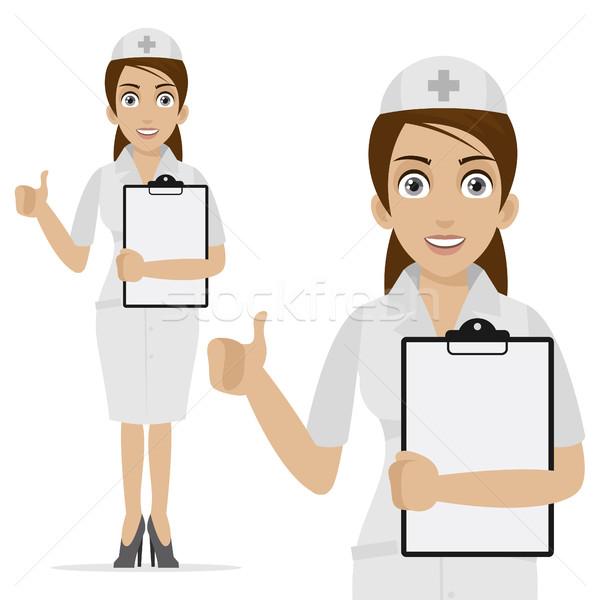 Nurse holds form and shows thumb up Stock photo © yuriytsirkunov