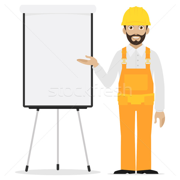 Builder points to flip chart Stock photo © yuriytsirkunov