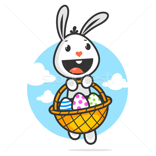 Stock photo: Happy easter bunny holds basket with eggs