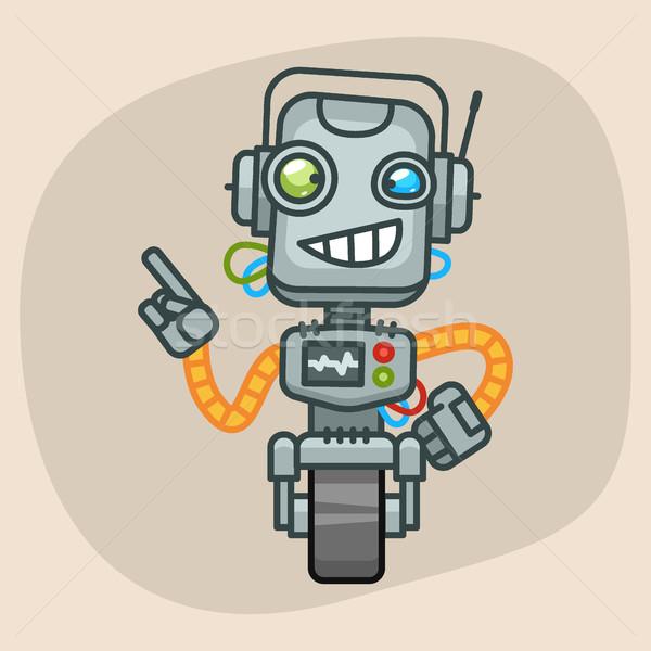Robot Smiling and Points Finger Stock photo © yuriytsirkunov