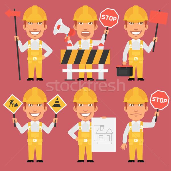 Builder Holds Different Signs Stock photo © yuriytsirkunov