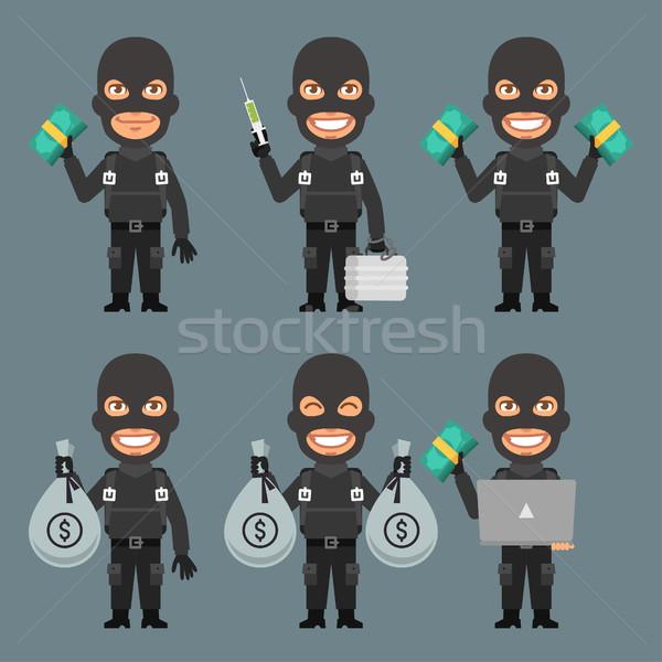 Robber Holds Money Suitcase Laptop Stock photo © yuriytsirkunov