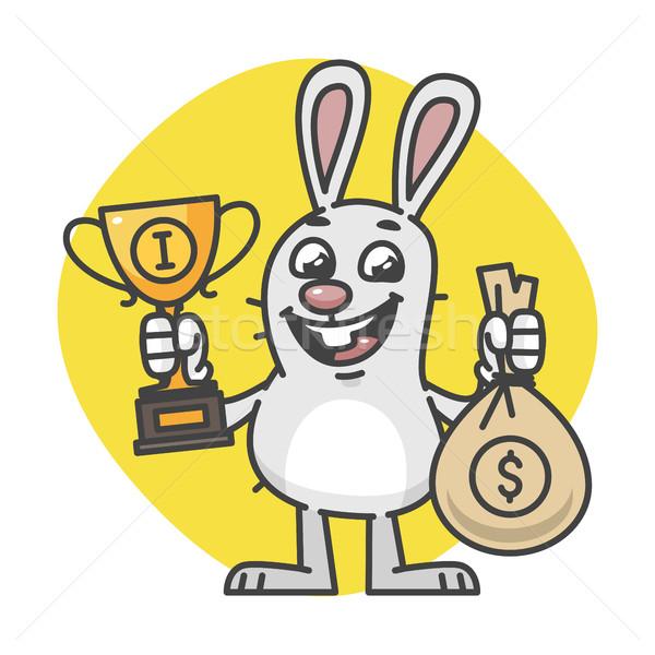 Bunny Holding Cup and Bag of Money Stock photo © yuriytsirkunov