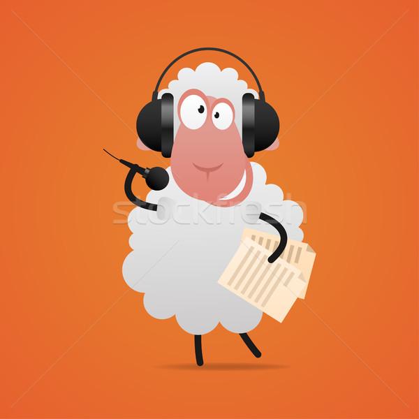 Cheerful sheep in headphones singing in microphone Stock photo © yuriytsirkunov