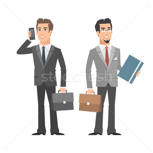 Biznesmen mówić telefonu folderze teczki Zdjęcia stock © yuriytsirkunov