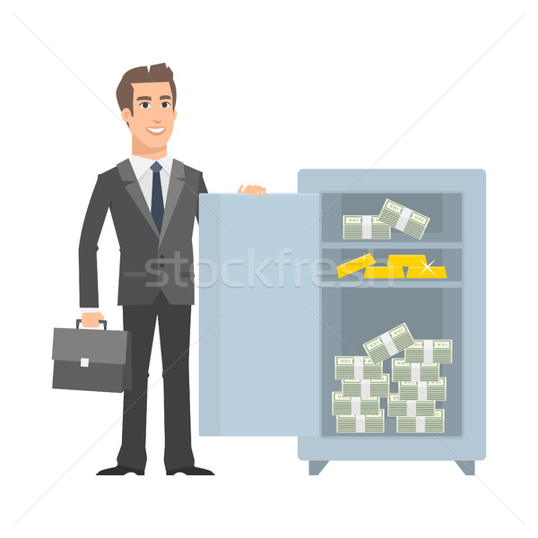 Businessman standing near with open safe and smiling Stock photo © yuriytsirkunov