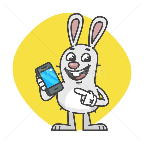 Bunny laughs and Indicates on Mobile Phone Stock photo © yuriytsirkunov