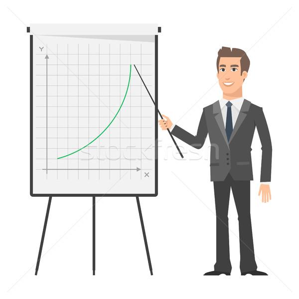 Businessman indicates on flip chart and smiling Stock photo © yuriytsirkunov