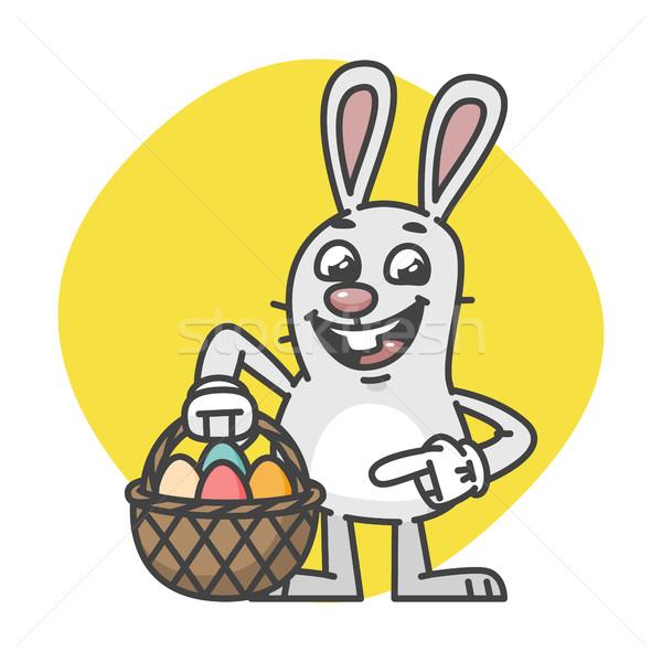 Easter Bunny Points on Basket with Eggs Stock photo © yuriytsirkunov
