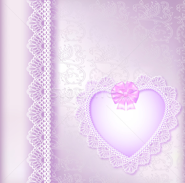 Stock photo:  background with a satin bow and a heart