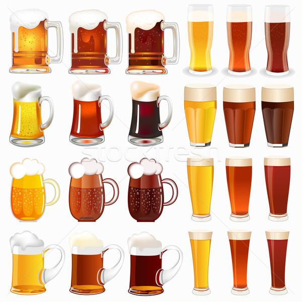 set of mugs with a light and dark beer Stock photo © yurkina