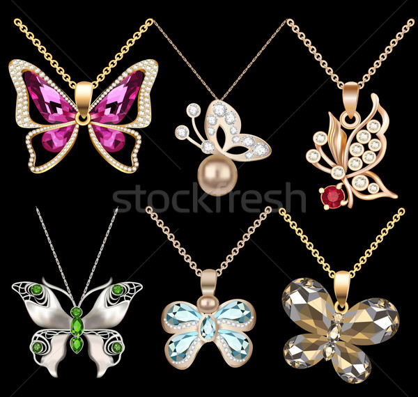 of a set of butterfly pendants with precious stones Stock photo © yurkina
