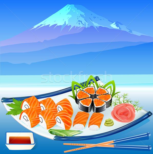 of sushi rolls with greenery on the background of Fujiyama Stock photo © yurkina