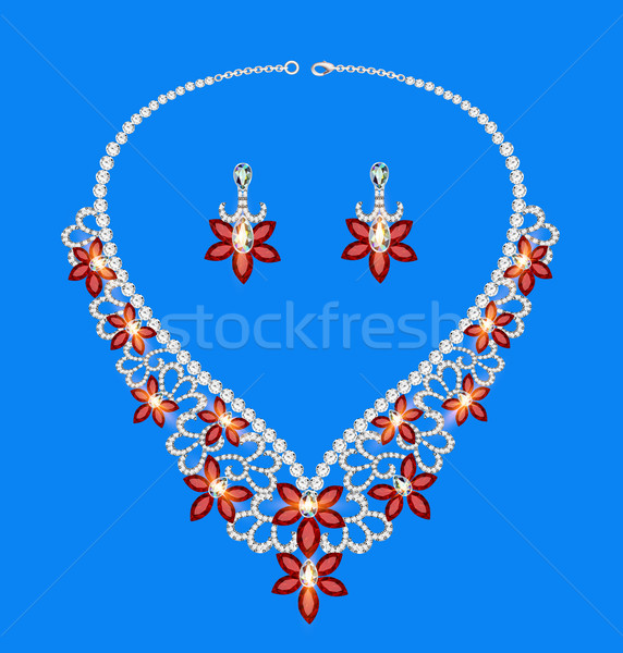 female necklace of precious stones on a blue background Stock photo © yurkina