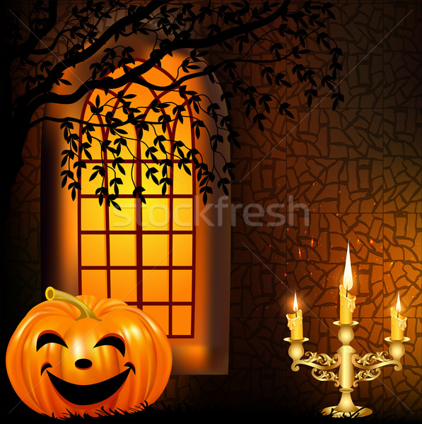 candle in a candlestick and a pumpkin on a background window on  Stock photo © yurkina