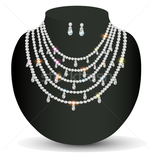 of a necklace and earrings with white precious stones Stock photo © yurkina