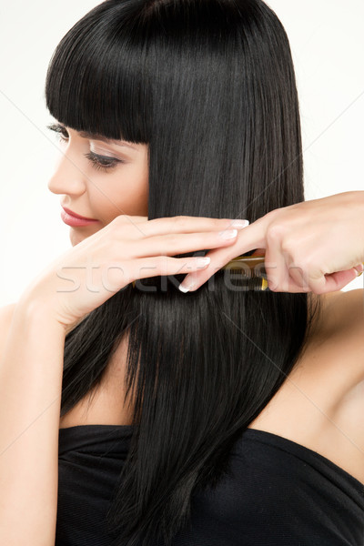 brunette brushing hair Stock photo © yurok