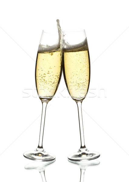 Stock photo: two glasses of sparkling wine clinking