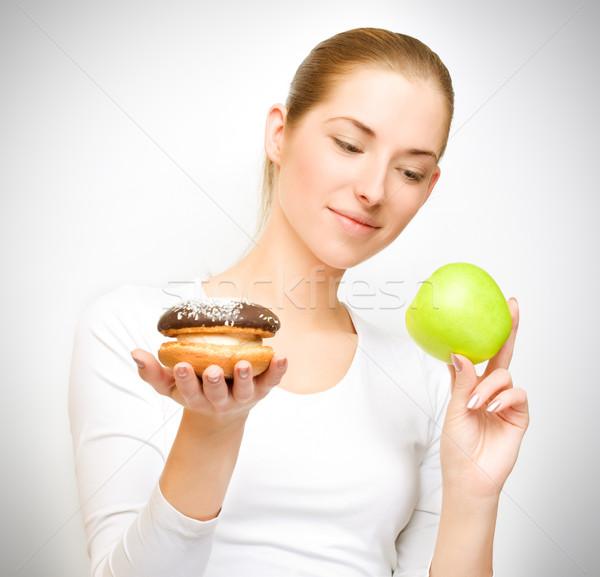 Appel vs cake kiezen gezond eten gezicht Stockfoto © yurok