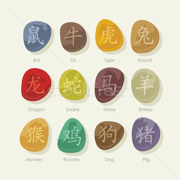 Pedras conjunto chinês zodíaco sinais colorido Foto stock © yurumi