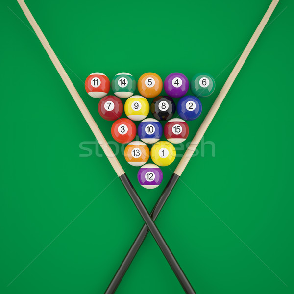 Billiard balls in a triangle with cues on green billiard table.  Stock photo © ZARost