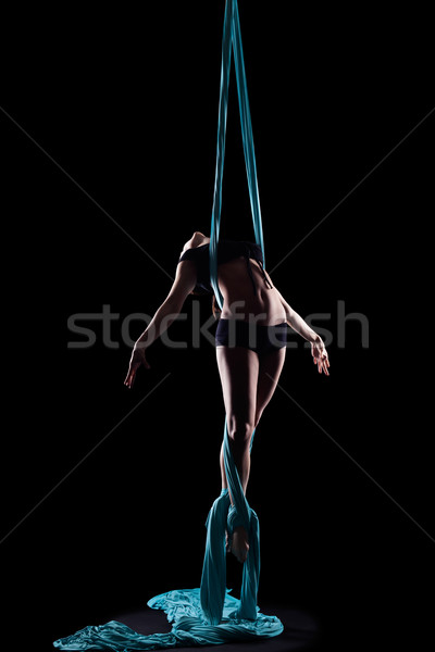 Young woman gymnast with blue gymnastic ribbon Stock photo © zastavkin