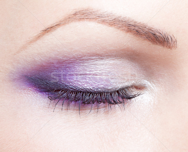 Stock photo: a closed eye of a woman