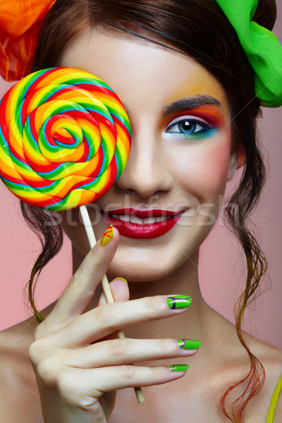 Girl wit lollipop Stock photo © zastavkin