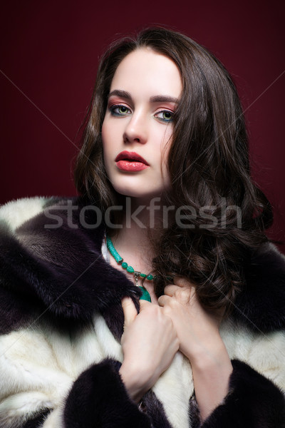 Young beautiful woman in fur coat and with green pistachio colou Stock photo © zastavkin