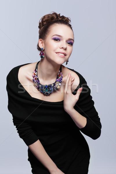 Genç kadın bijuteri gri siyah elbise el yüz Stok fotoğraf © zastavkin