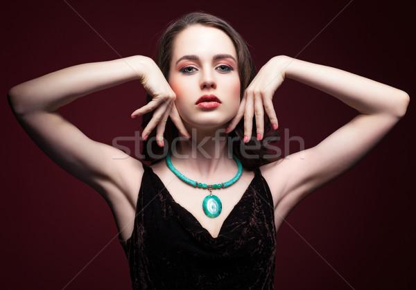 Young beautiful woman in black dress with green pistachio colour Stock photo © zastavkin